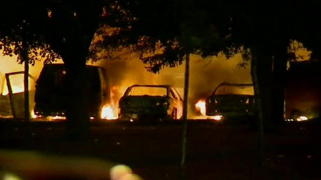 Buildings and cars alight