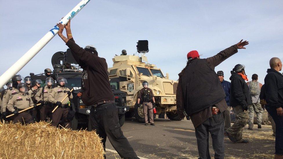 Dakota Access pipeline protesters confront law enforcement on Thursday, Oct. 27, 2016, near Cannon Ball, N.D