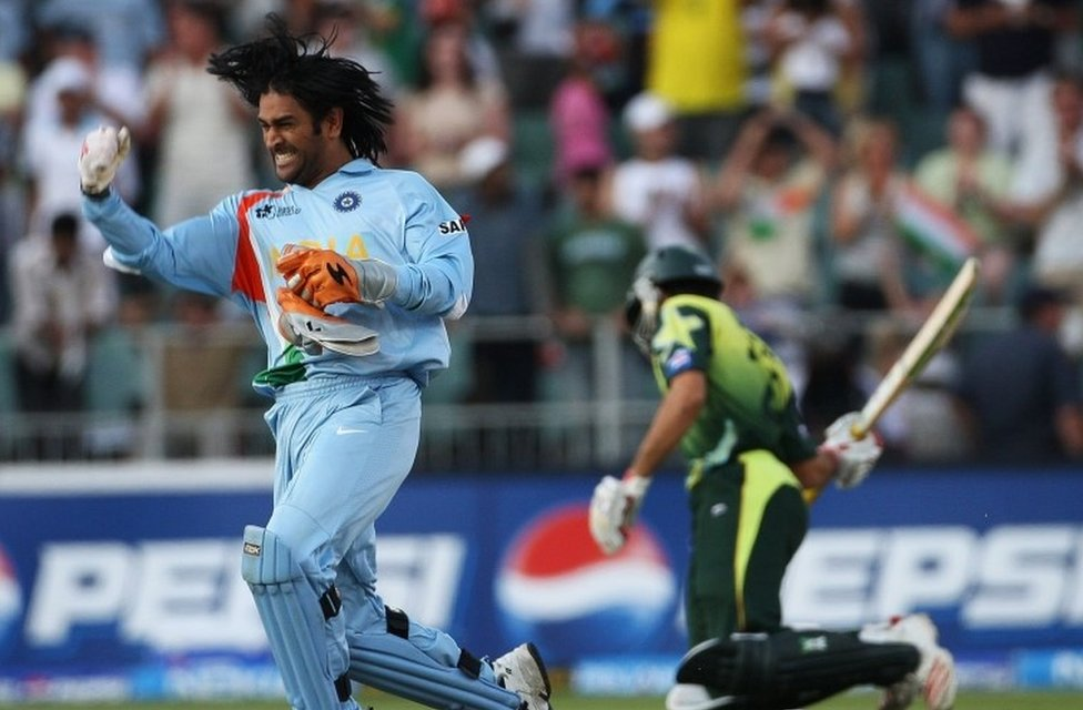 """MS Dhoni of India celebrates his team""""s victory with Misbah-ul-Haq of Pakistan looking on the World Twenty20 Final match between Pakistan and India at The Wanderers Stadium on September 24, 2007"""