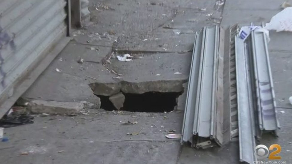 A picture of the pavement that a man fell through in New York