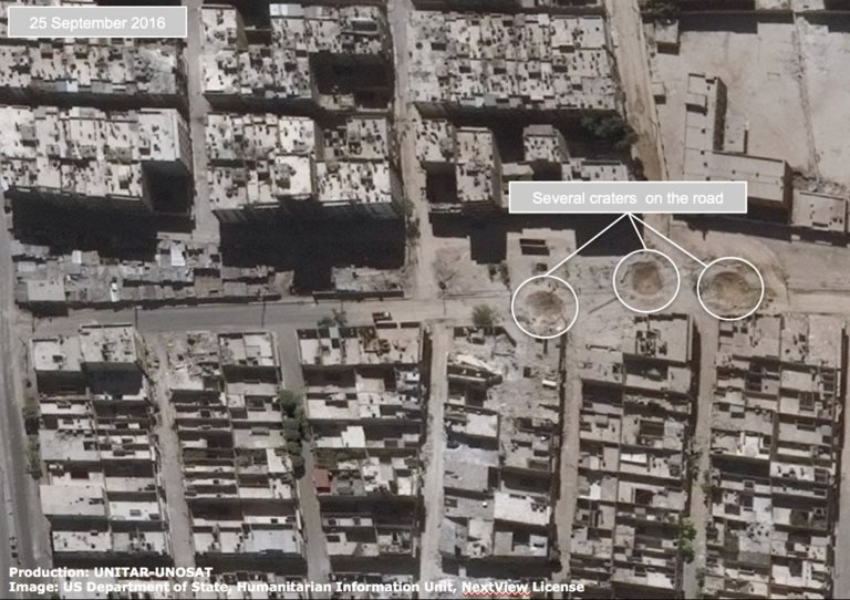 Satellite image shows road damage and craters in the al-Shaar district of Aleppo on 25 September