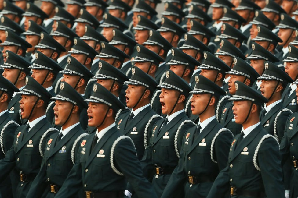 Soldiers of the People's Liberation Army shout during the rehearsal of the parade on the morning of 1 October 2019, in Tiananmen Square, Beijing.