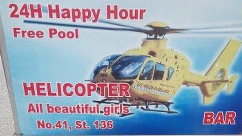 East Anglian Air Ambulance on Cambodian bar advert