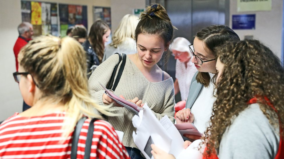 Students checking A-level results at Peter Symonds College, Winchester