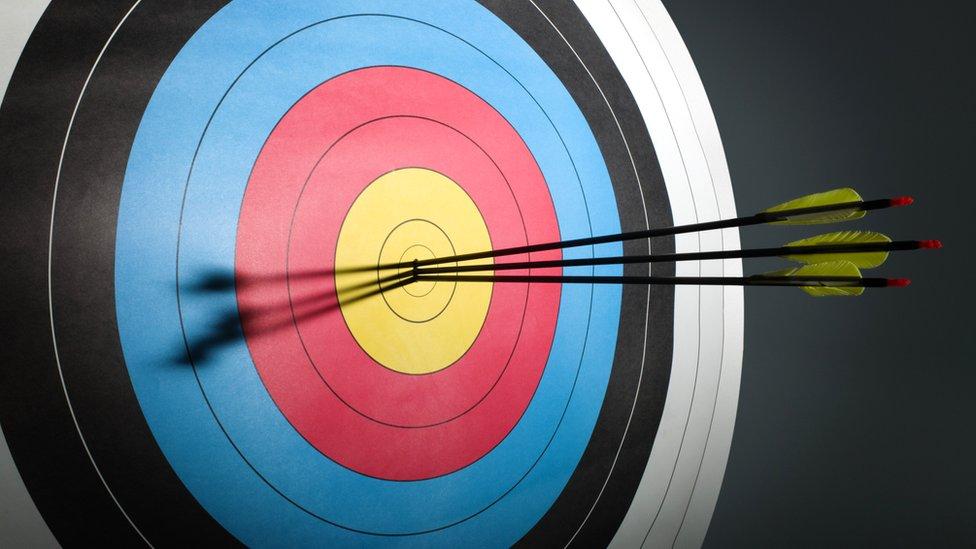 Three arrows in an archery target