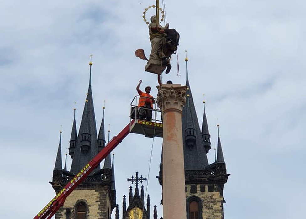Statue being lowered in Prague