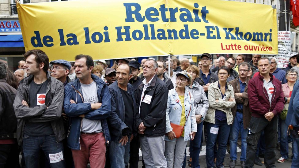 "Members of France""s ""Lutte ouvriere "" take part in a protest"