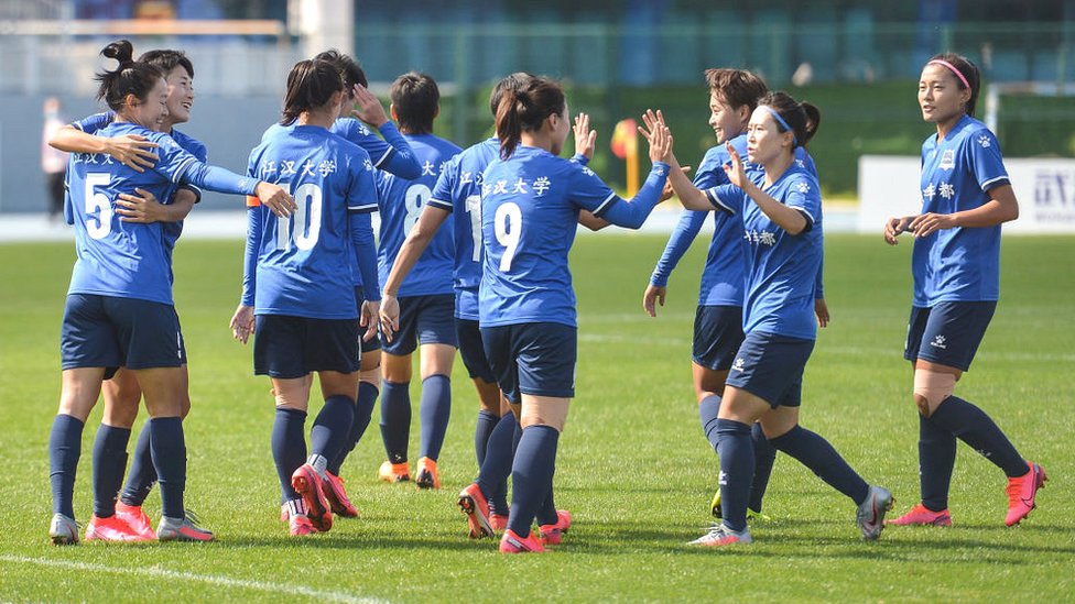 Players of Wuhan Jianghan University react during their Chinese Football Association (CFA) women's super league match against Henan Jianye women FC in Kunming in China's south-western Yunnan province on 23 August 2020
