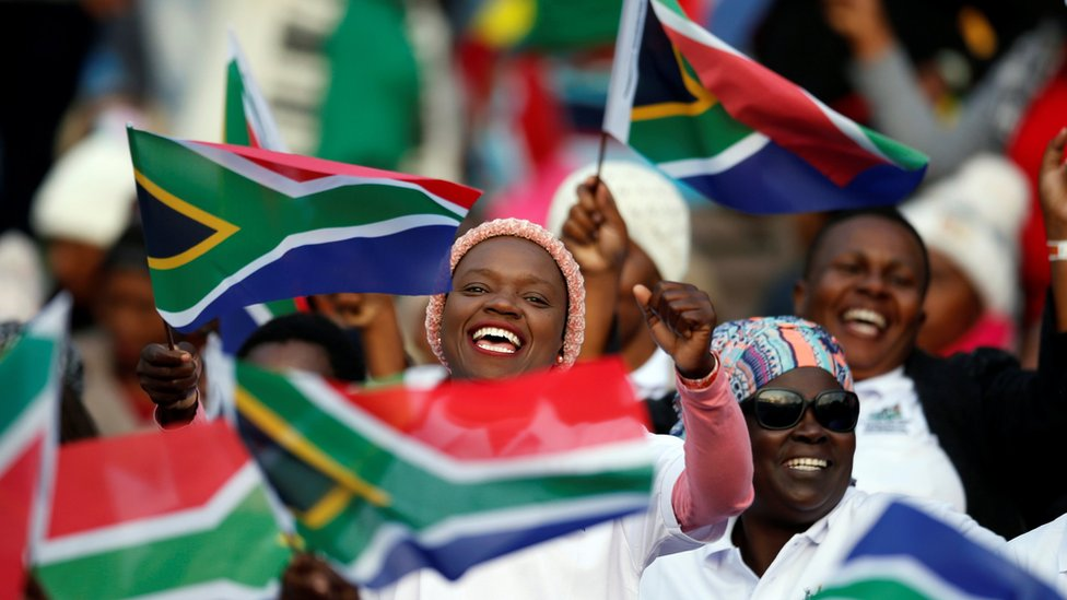 South Africans cheering and waving flags