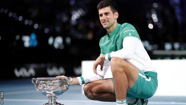 Novak Djokovic celebrates his Australian Open win