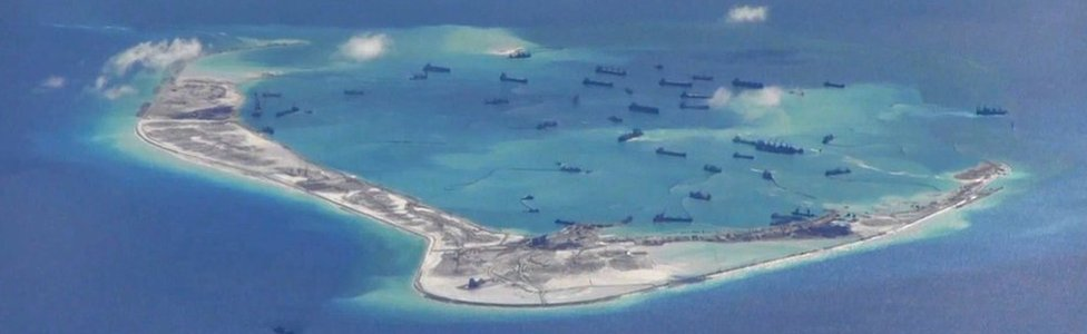 Chinese dredging vessels are purportedly seen in the waters around Mischief Reef in the disputed Spratly Islands in the South China Sea in this file still image from video taken by a P-8A Poseidon surveillance aircraft provided by the United States Navy 21 May 2015