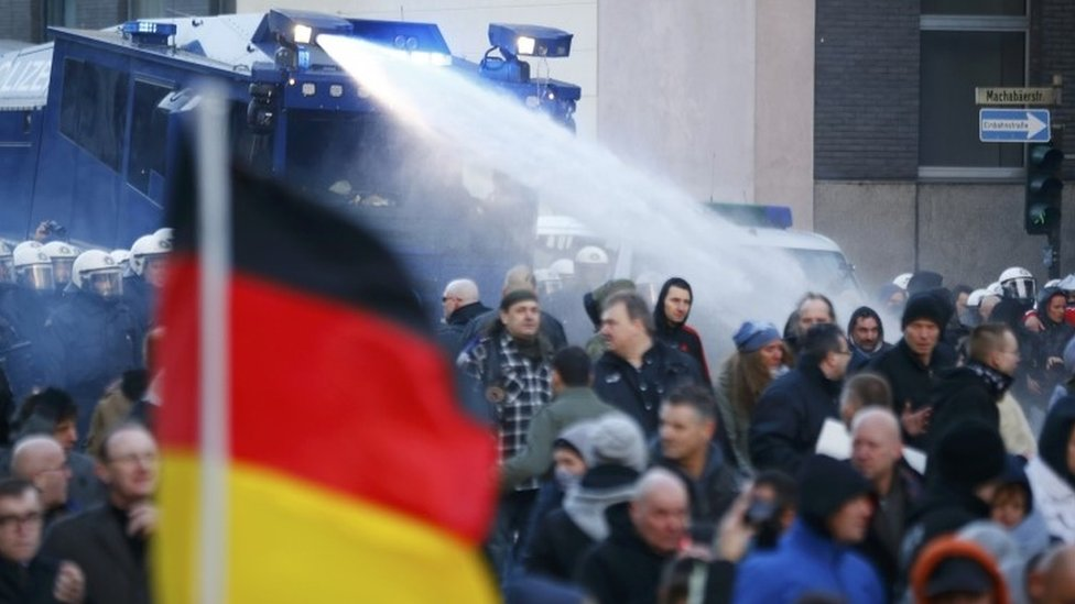 Police use water cannon during a protest march by supporters of anti-immigration right-wing movement PEGIDA (Patriotic Europeans Against the Islamisation of the West) in Cologne, Germany, January 9, 2016