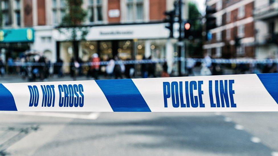 Police Line tape at a street crime scene