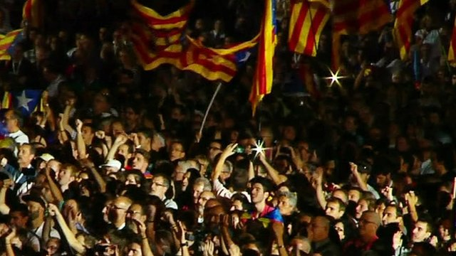 Pro-independence supporters waving Catalan flags