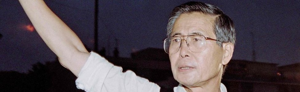 Alberto Fujimori waving as he leaves the residence of the Japanese ambassador in Lima, 22 April 1997