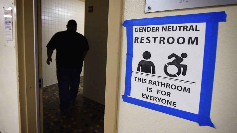 This file photo taken on May 4, 2016 shows signs posted outside the Santee High School's gender neutral restrooms at their campus in Los Angeles, California.