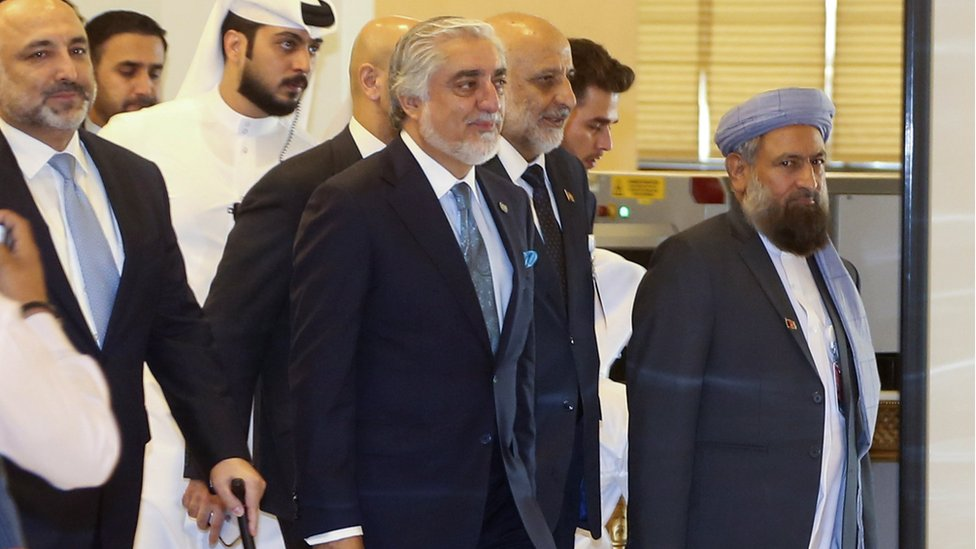 Afghanistan Peace Grand Council chief, Abdullah Abdullah (C) arrives for the opening session of the peace talks between the Afghan government and the Taliban in Doha, Qatar, 12 September 2020