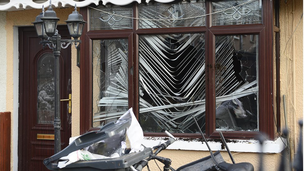 Damage to the front window of the house at Etna Drive