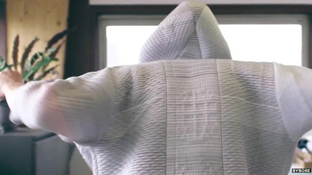 A man wearing a 'smart' suit that can clean the air