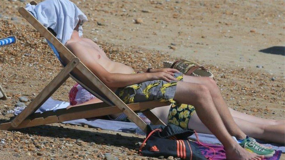 Man on deckchair on British beach
