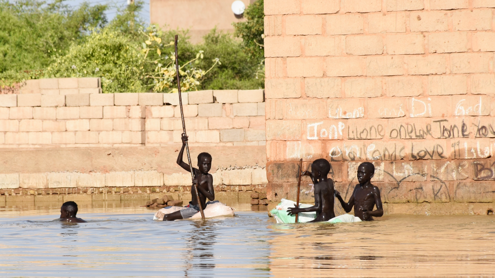 Children playing in flood water in Omdurman, Sudan - 2020
