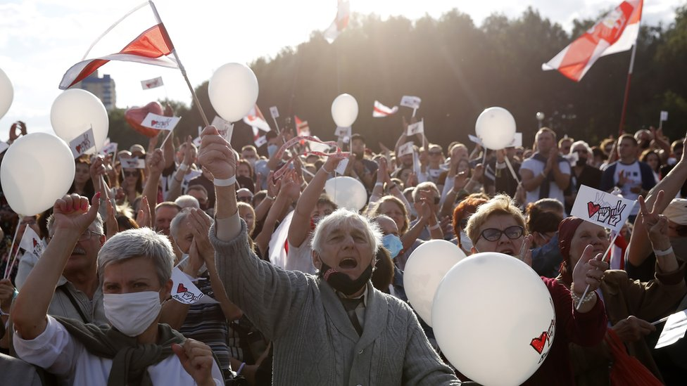 People attend a campaign rally of the Belarusian opposition presidential candidate