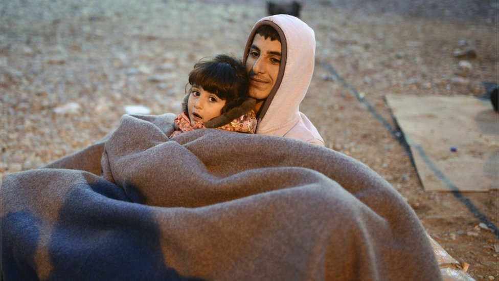 Man and child under a blanket (Getty Images)