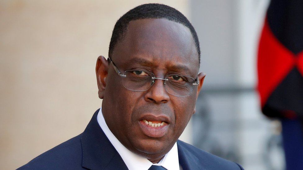 President Macky Sall leaving a conference