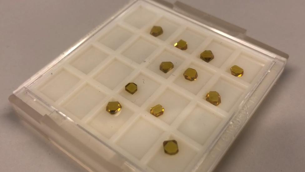 A tray of yellow diamonds