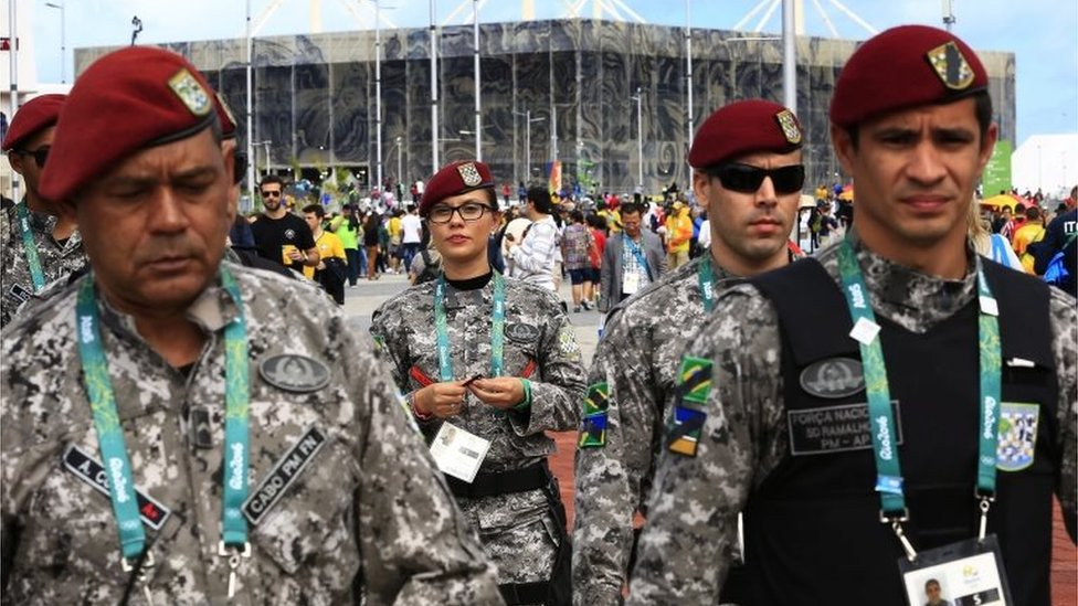 Brazilian soldiers among spectators inside the Barra Olympic Park with the Aquatic Center seen in background during the Rio 2016 Olympic Games in Rio de Janeiro, Brazil, 12 August 2016.