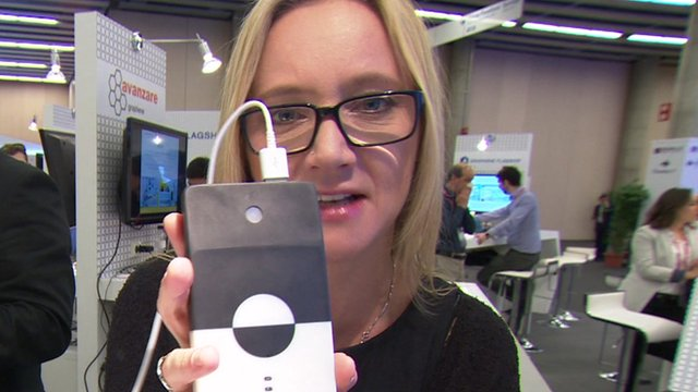 BBC Click's Kate Russell holds a graphene powered charger pack