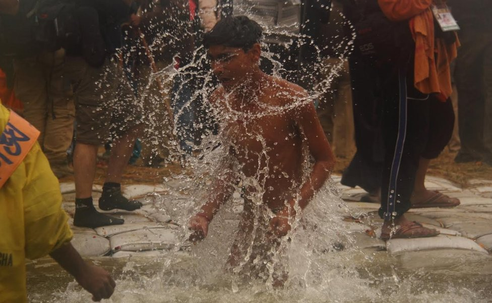 A man taking a dip in the Ganges
