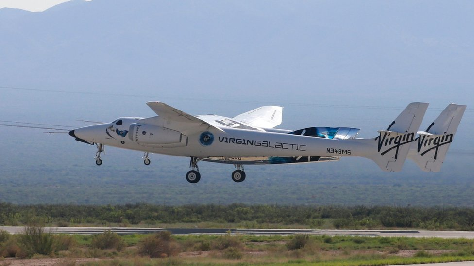 """Virgin Galactic""""s passenger rocket plane VSS Unity, borne by twin-fuselage carrier jet dubbed VMS Eve, takes off with billionaire entrepreneur Richard Branson and his crew for travel to the edge of space at Spaceport America near Truth or Consequences, New Mexico, U.S., July 11, 2021"""