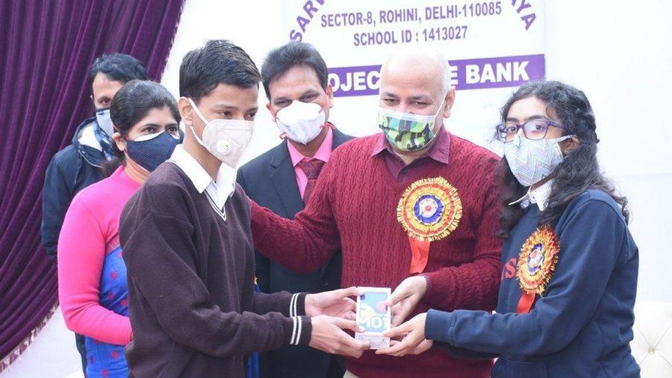 Deputy Chief Mister of Delhi Manish Sisodia giving away phones to students