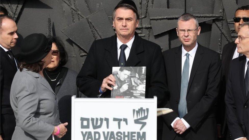 Brazilian President Jair Bolsonaro (C) during a memorial ceremony at the Hall of Remembrance in the Yad Vashem Holocaust memorial museum in Jerusalem, Israel, 02 April 2019.