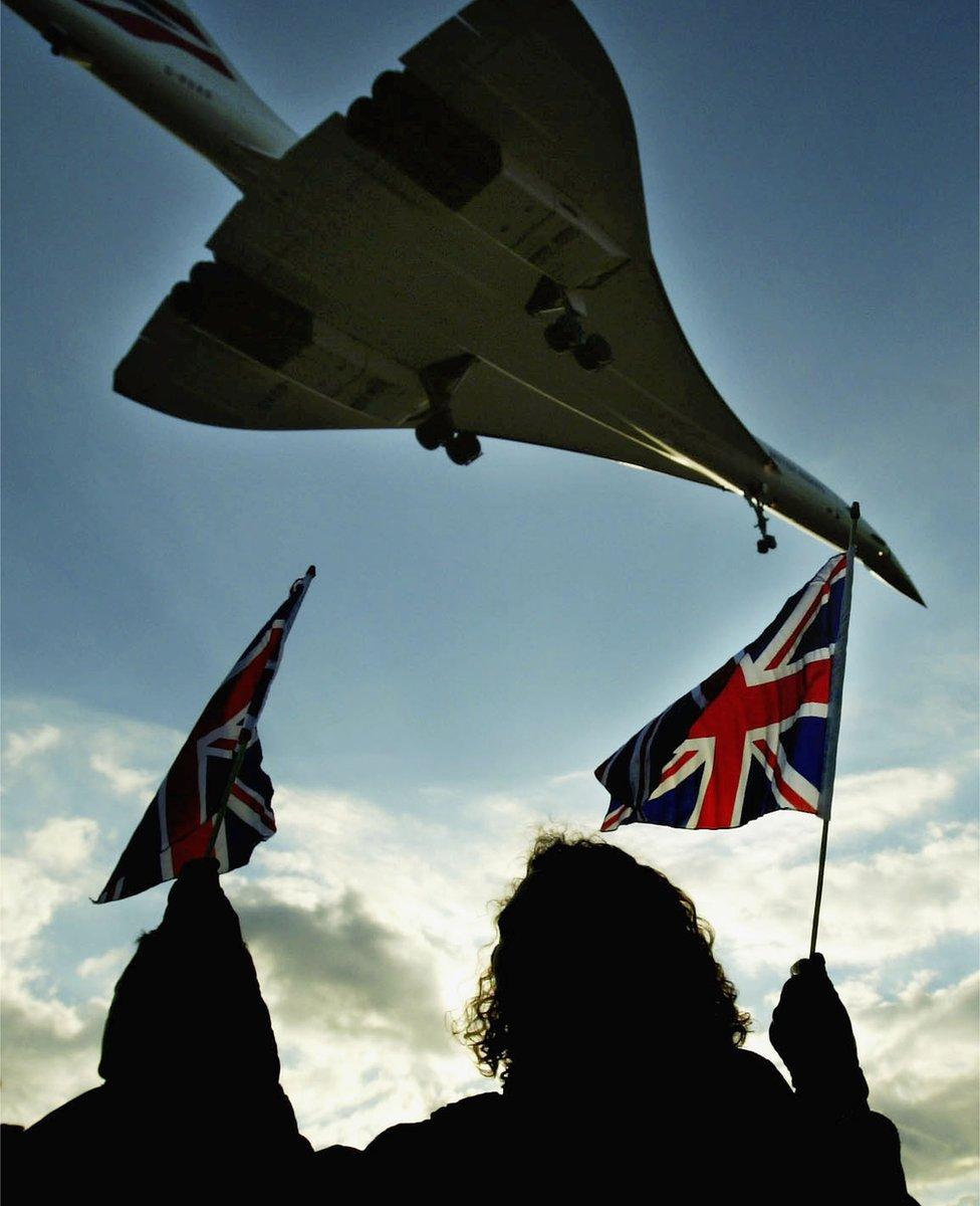 Flag-wavers looking at Concorde