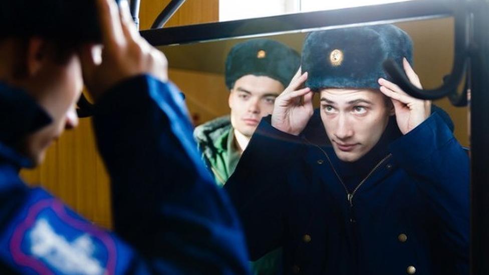Russian conscript tries on uniform