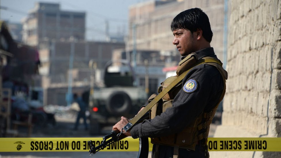 A member of Afghan security forces stands guard