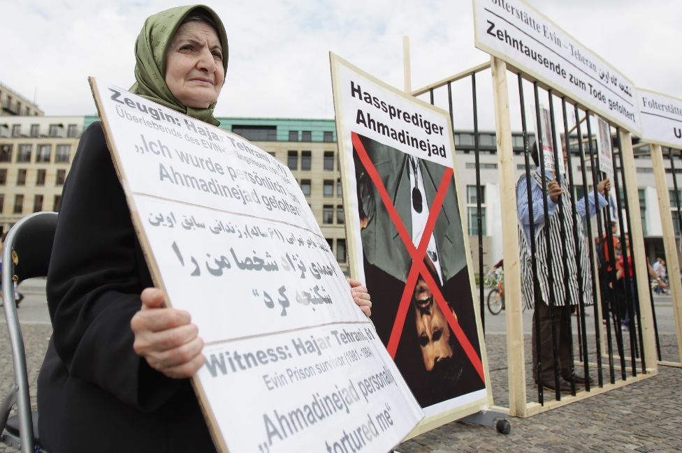 This picture shows Hajar Tehrani, a survivor of Iran's Evin prison, protesting against stoning in Berlin, Germany