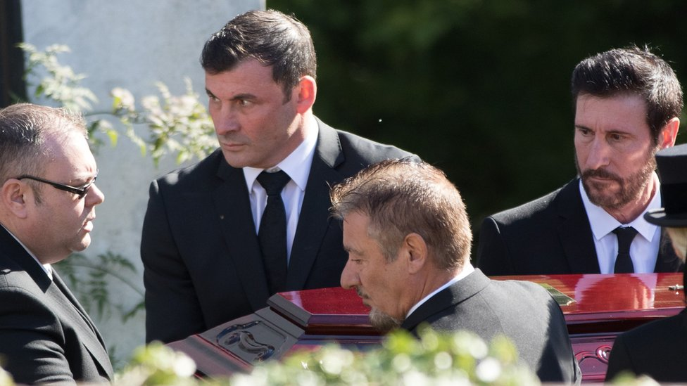 Pallbearers preparing to carry Joe Calzaghe's coffin into Our Lady of Peace Parish Church in Newbridge