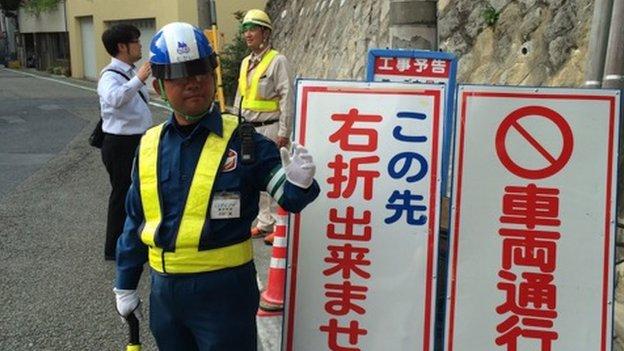 Human traffic light officer in Japan