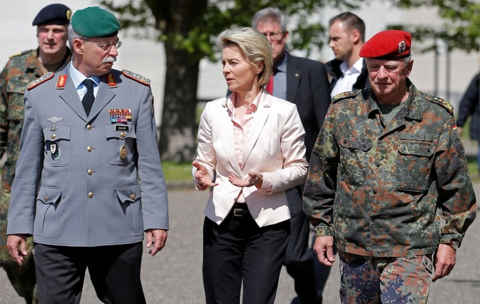German Defence Minister Ursula von der Leyen (C) walks with General Joerg Vollmer, General Inspector of the German Land Army (L), and General Volker Wieker, Inspector General of Germany' Armed Forces in Bundeswehr, during her visit to the 291st fighter squadron in Illkirch on 3 May, 2017.