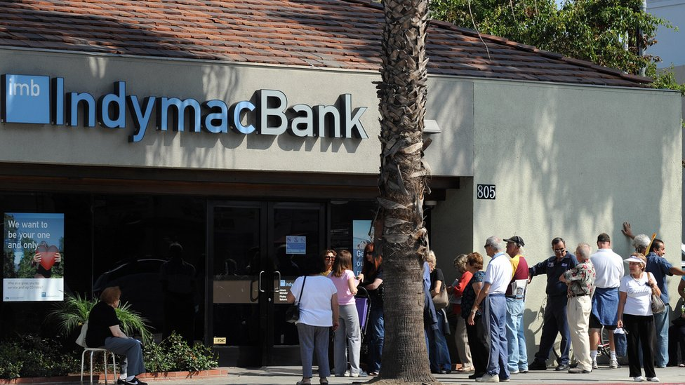 Customers line up in front of an IndyMac branch in July 2008