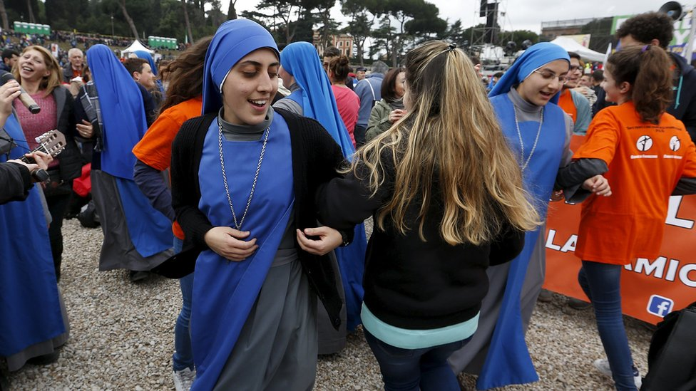 Nuns dance at a rally against same-sex unions