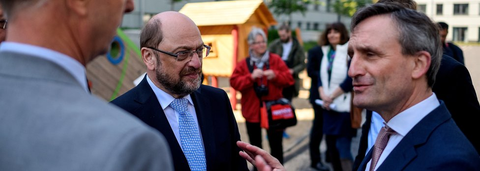 Martin Schulz, leader of the German Social Democrats (SPD), chats with local residents as he campaigns on behalf of the SPD ahead of state elections in North Rhine-Westphalia on May 10, 2017 in Düsseldorf.