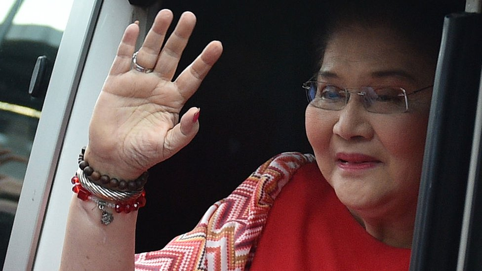 Philippines' former first lady Imelda Marcos waves to the crowd as she arrives for her son vice-presidential candidate Ferdinand Marcos Jnr's 'miting-de-avance' in Manila on May 5, 2016.