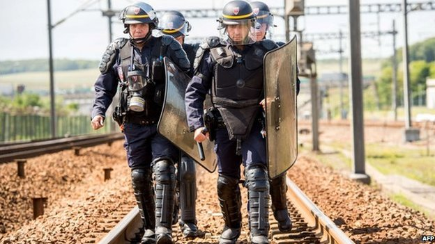 French riot police on a train line