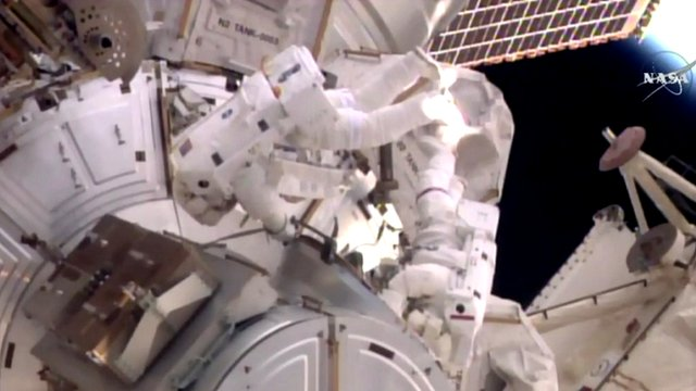 astronaut mid-space walk