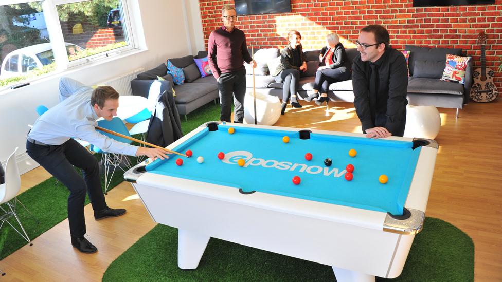 Staff playing pool