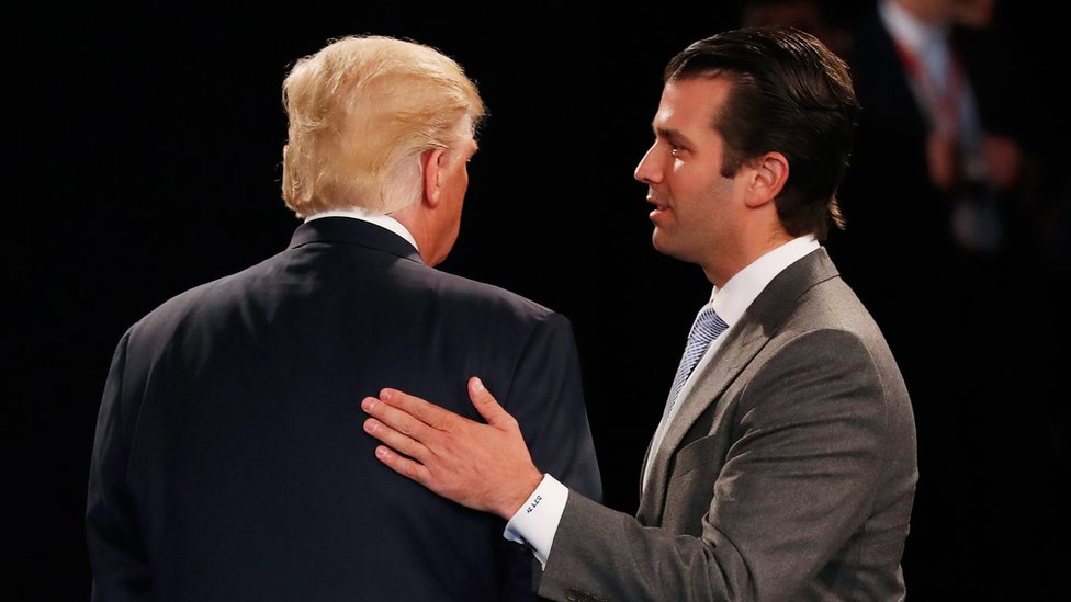 Donald Trump Jr greets his father Republican presidential nominee Donald Trump during a debate in October 2016
